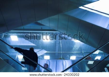 Mooving escalators in airport - stock photo