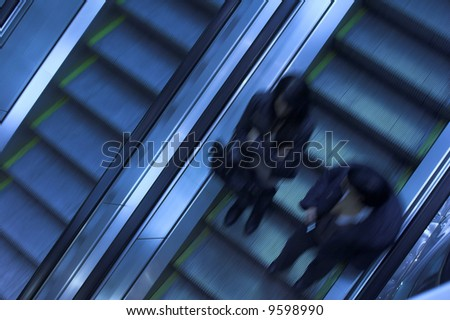 Mooving escalators in airport - stock photo