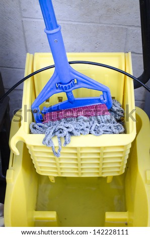 Mop and bucket - clean up time - stock photo