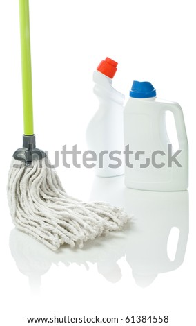mop and cleaning bottles - stock photo