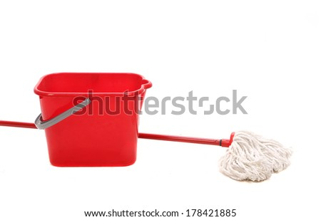 Mop and red bucket. Isolated on a white background. - stock photo