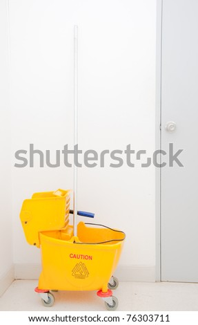 mop and yellow bucket - stock photo