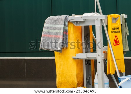 Mop bucket and wringer cleaning in process - stock photo