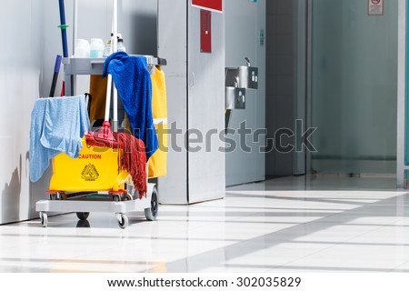 Mop bucket on cleaning in process indoor - stock photo
