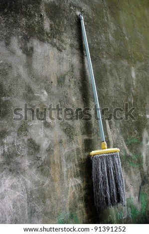 mop hanging on the wall