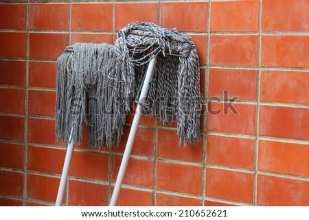 Mop the Wall - stock photo