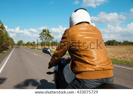 Moped drivers on road in summer day - Travel by motorcycle Concept - stock photo
