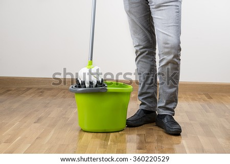 Mopping the floor with space for your text.     - stock photo