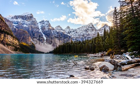 Moraine Lake and the surrounding snow capped mountains in Banff National Park in the Canadian Rockies under blue sky - stock photo