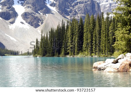 Moraine Lake in Lake Louise, Banff National Park, Alberta, Canada. Blue water, fir trees and beautiful snowy mountains