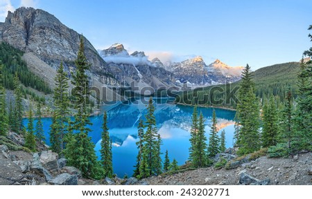 Moraine Lake is a glacially-fed lake in Banff National Park. When it is full, it reflects a distinct shade of blue. - stock photo