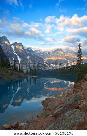 Moraine Lake shortly after sunrise. - stock photo