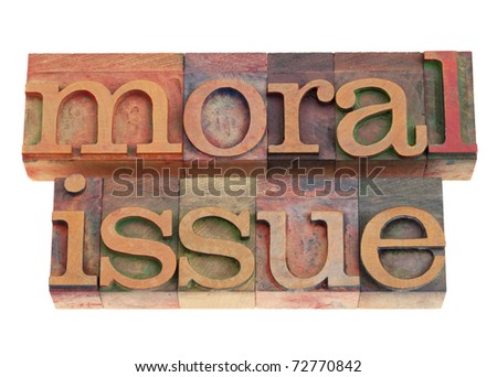 moral issue phrase in vintage wood letterpress printing blocks, isolated on white - stock photo