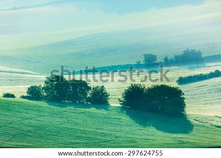 Moravian rolling fields landscape in morning mist. Moravia, Czech Republic - stock photo