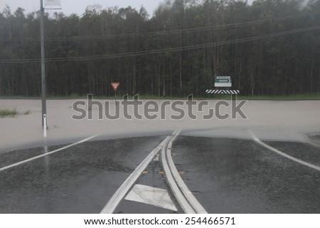 MORAYFIELD, AUSTRALIA - FEBRUARY 21: Cyclone Marcia flooded roadway on Feburay 21, 2015 in Morayfield, Australia - stock photo