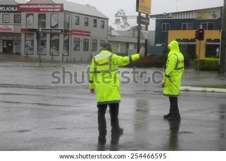 MORAYFIELD, AUSTRALIA - FEBRUARY 21: Police controlling flooded roadways caused by cyclone Marcia  on Feburay 21, 2015 in Morayfield, Australia - stock photo