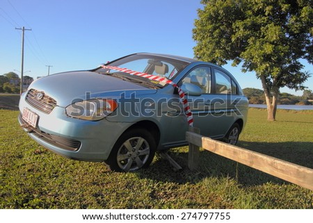 MORAYFIELD, AUSTRALIA - MAY 2: Car that was washed away during flash flood and left dry on fence, flood killed five in cars on May 2, 2015 in Morayfield, Australia - stock photo
