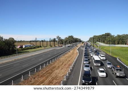 MORAYFIELD, AUSTRALIA - MAY 2: Flash flooding causes heavy M1 traffic congestion northbound towards sunshine coast on May 2, 2015 in Morayfield, Australia - stock photo