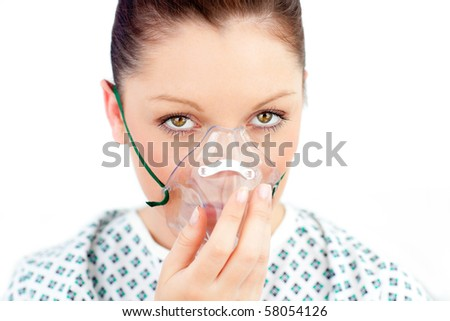 Morbid caucasian  woman wearing a mask looking at the camera against white background - stock photo
