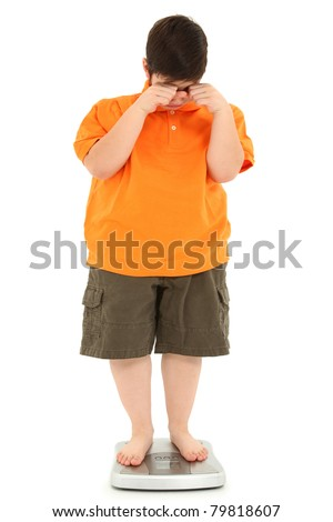 Morbidly obese fat child on scale crying. Weight loss Concept. - stock photo