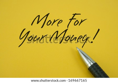More For Your Money note with pen on yellow background - stock photo