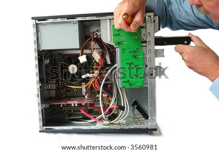 More Memory, IT Man services Desktop and replaces Hard Drive - stock photo