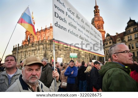 More than a thousand protesters gather for an Anti-Islamization rally in Dresden, Germany Monday September 28, 2015.. - stock photo