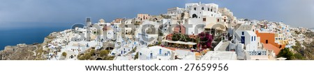 More than 180 degrees panorama of Oia village at beautiful island of Santorini, Greece - stock photo