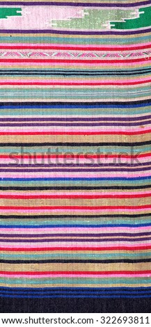More than 100 years old colorful thai handcraft peruvian style rug surface old vintage  beautiful background detail pattern thai silk fashionable farabic fashoin  thai silk background farabic textures - stock photo