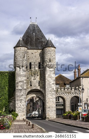MORET-SUR-LOING, FRANCE - JULY 15, 2012: Cityscape of Moret-sur-Loing. Moret-sur-Loing is a commune in Seine-et-Marne department in the Ile-de-France region on the banks of Seine river. - stock photo