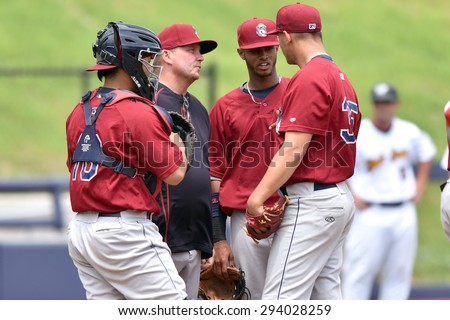 MORGANTOWN, WV - JUNE 21: Mahoning Valley Scrappers pitching coach Greg Hibbard (37) talks with the pitcher on the mound in a NY-Penn League minor league baseball game June 21, 2015 in Morgantown, WV.