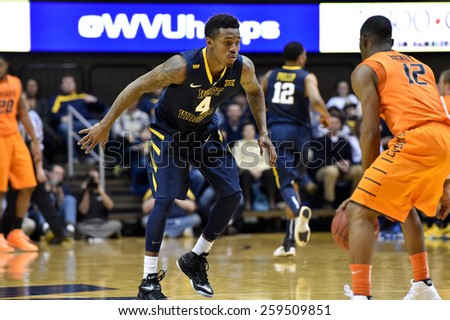 MORGANTOWN, WV - MARCH 7: West Virginia Mountaineers guard Daxter Miles Jr. (4) plays defense during the Big 12 Conference college basketball game March 7, 2015 in Morgantown, WV.  - stock photo