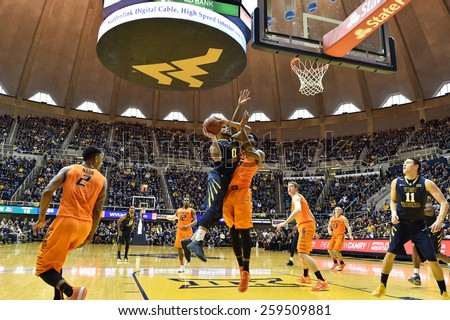 MORGANTOWN, WV - MARCH 7: West Virginia Mountaineers guard Jaysean Paige (0) puts up a contested shot during the Big 12 Conference college basketball game March 7, 2015 in Morgantown, WV.  - stock photo