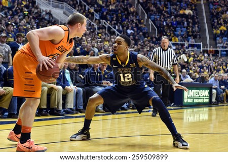 MORGANTOWN, WV - MARCH 7: West Virginia Mountaineers guard Tarik Phillip (12) plays defense during the Big 12 Conference college basketball game March 7, 2015 in Morgantown, WV.  - stock photo