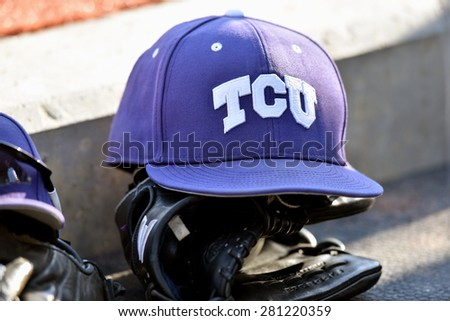MORGANTOWN, WV - MAY 2: A TCU hat and glove rest on the dugout steps during a Big 12 conference baseball game May 2, 2015 in Morgantown, WV.  - stock photo