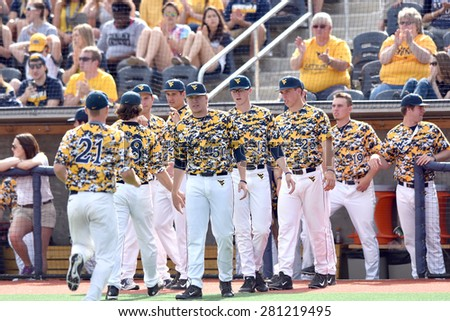 MORGANTOWN, WV - MAY 2: The WVU bench congratulates the defense leaving the field during a Big 12 conference baseball game May 2, 2015 in Morgantown, WV.