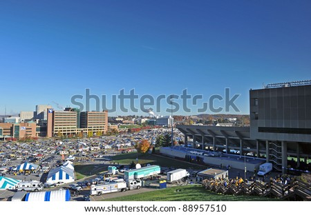 MORGANTOWN, WV - NOVEMBER 5: Tailgaters fill the lots in front of Ruby Memorial Hospital (center w/ logo) prior to the WVU- Louisville game on the campus of WVU on November 5, 2011 in Morgantown, WV. - stock photo