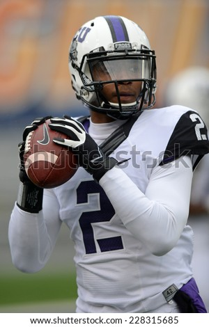 MORGANTOWN, WV - November 1: TCU quarterback Travone Boykin (2) throws a pass in the Big 12 football game November 1, 2014 in Morgantown, WV.  - stock photo