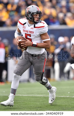 MORGANTOWN, WV - NOVEMBER 7: Texas Tech Red Raiders quarterback Patrick Mahomes (5) rolls out to pass during the NCAA football game November 7, 2015 in Morgantown, WV.  - stock photo