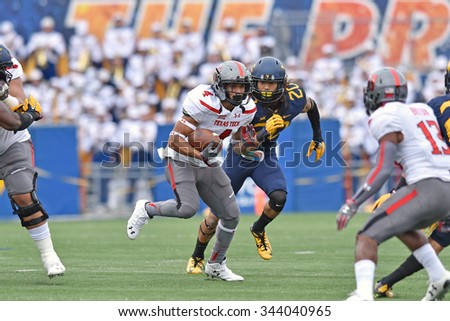 MORGANTOWN, WV - NOVEMBER 7: Texas Tech Red Raiders running back Justin Stockton (4) runs with the ball during the NCAA football game November 7, 2015 in Morgantown, WV.  - stock photo