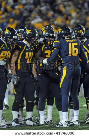 MORGANTOWN, WV - NOVEMBER 27: The WVU Mountaineer offense huddle up during the November 27, 2009 game in Morgantown, WV. WVU upset Pitt 19-16 in the game. - stock photo