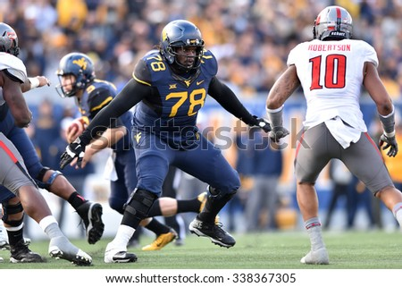 MORGANTOWN, WV - NOVEMBER 7: West Virginia Mountaineers offensive lineman Marquis Lucas (78) looks for a block during the football game November 7, 2015 in Morgantown, WV. - stock photo