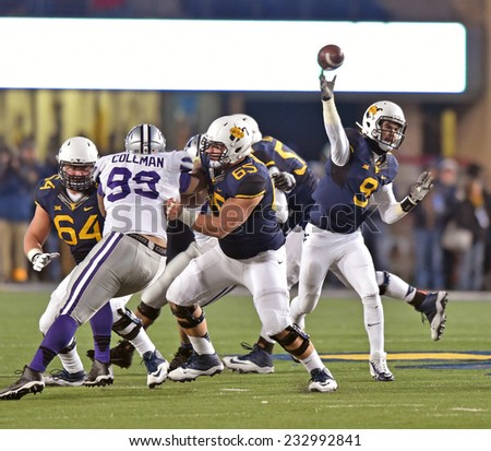 MORGANTOWN, WV - NOVEMBER 20: West Virginia Mountaineers quarterback Clint Trickett (9) throws from the pocket during a football game November 20, 2014 in Morgantown, WV.  - stock photo