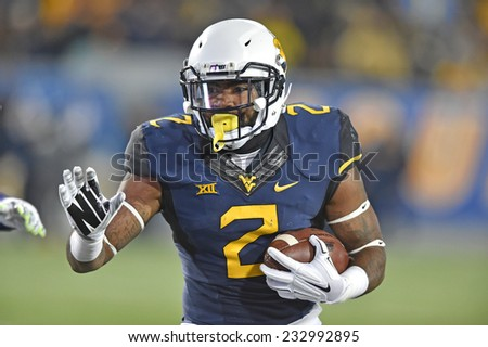 MORGANTOWN, WV - NOVEMBER 20: West Virginia Mountaineers running back Dreamius Smith (2) runs with the ball in a football game November 20, 2014 in Morgantown, WV.