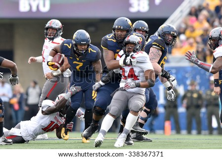 MORGANTOWN, WV - NOVEMBER 7: West Virginia Mountaineers running back Rushel Shell (7) follows a blocker on a carry during the football game November 7, 2015 in Morgantown, WV. - stock photo