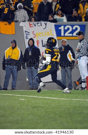 MORGANTOWN, WV - NOVEMBER 27: West Virginia returner Mark Rodgers gathers in a kick during the November 27, 2009 win against Pitt in Morgantown, WV. - stock photo