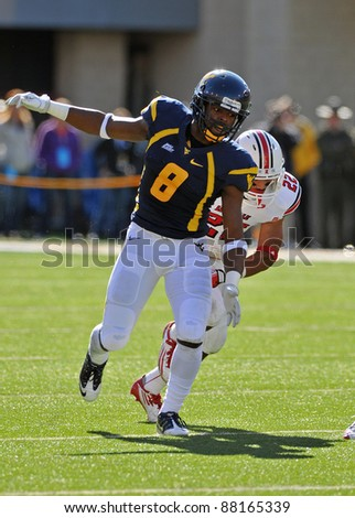 MORGANTOWN, WV - NOVEMBER 5: WVU defensive back Keith Tandy (#8) breaks downfield to cover a punt early in the football game against Louisville November 5, 2011 in Morgantown, WV.