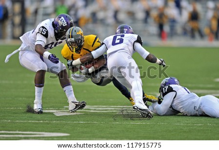 MORGANTOWN, WV - NOVEMBER 3: WVU receiver Tavon Austin (yellow) is tackled by a hist of defenders during a Big 12 conference football game between TCU & WVU November 3, 2012 in Morgantown, WV.