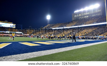 """MORGANTOWN, WV - OCTOBER 10: Fans """"stripe the stadium"""" for the WVU home football game October 10, 2015 in Morgantown, WV.  - stock photo"""