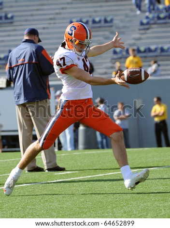 MORGANTOWN, WV - OCTOBER 23: Syracuse punter Ryan Long kicks the ball during pregame drills October 23, 2010 in Morgantown, WV. - stock photo